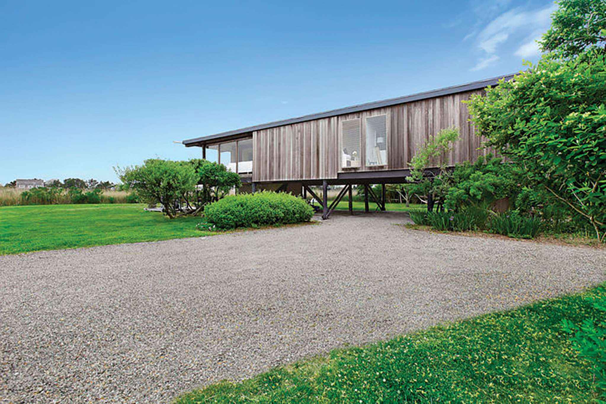 Additional photo for property listing at Waterfront With Dock And Just Feet From The Ocean  Bridgehampton, New York